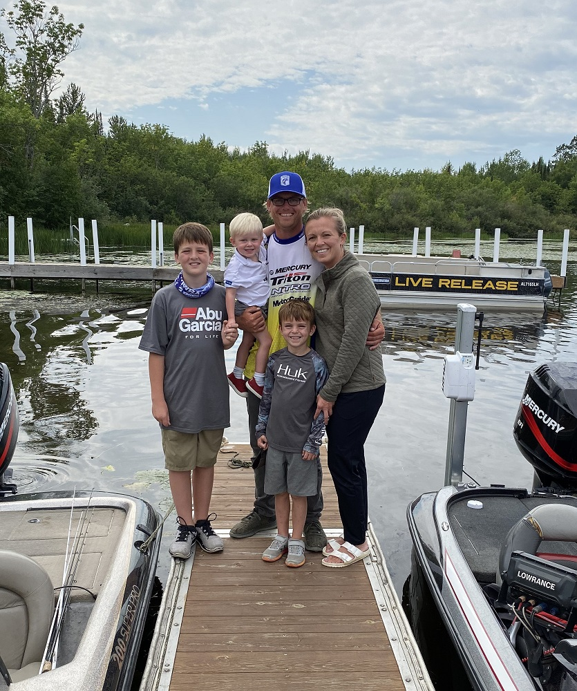 Eric Storms at the dock with his family