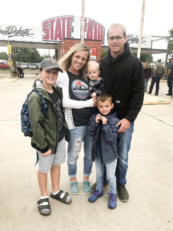 Eric Storms with his wife and 3 sons